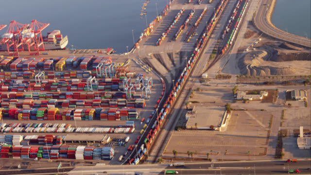 aerial view of container port with rail terminal and shunting (also called switching) yard at beginning of clip; note length of trains! red r3d 4k, 4k, 4kmstr - shunting yard stock videos and b-roll footage