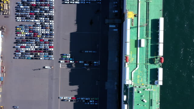 aerial view of container ship and many cars before shipping - ultra high definition television stock videos & royalty-free footage
