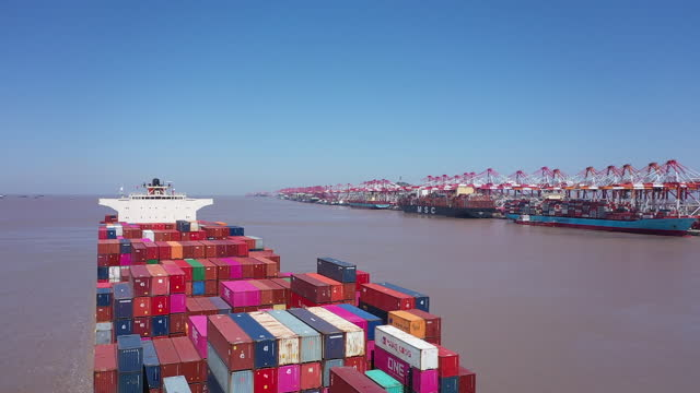 aerial view of container ship and yangshan port ahead of trade figures release, in shanghai, china, on friday, april 9, 2021. china is scheduled to... - container video stock e b–roll