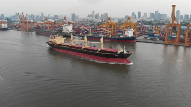 aerial view of container ship at dockyard for logistic - container stock videos & royalty-free footage
