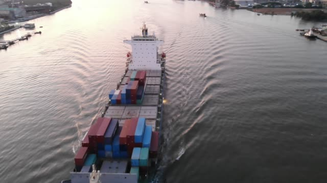 Aerial view of container ship exports on the river