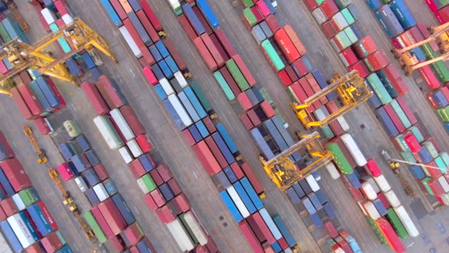 aerial view of container ship in industrial port - docks stock videos & royalty-free footage