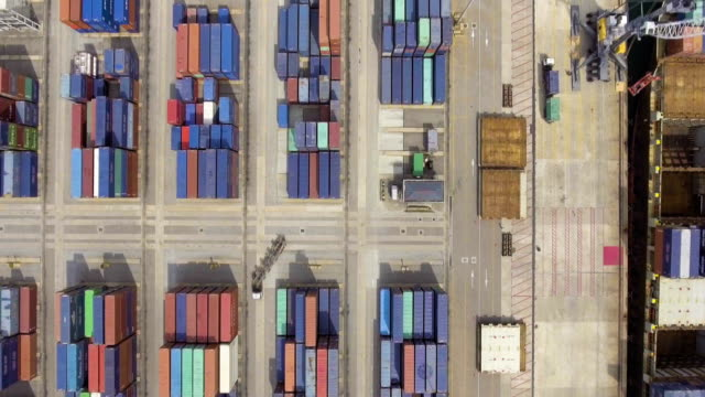 aerial view of container ship in industrial port - economy stock videos & royalty-free footage