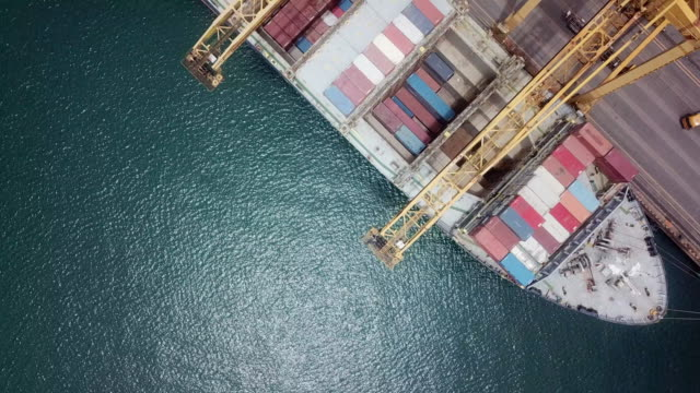 aerial view of container ship in port - container ship stock videos & royalty-free footage