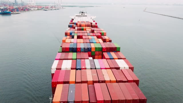 aerial view of container ship in sea - container stock videos & royalty-free footage