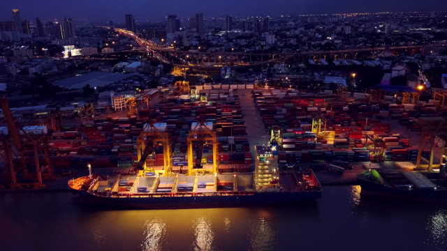 Aerial View of Container ship in the harbor at night