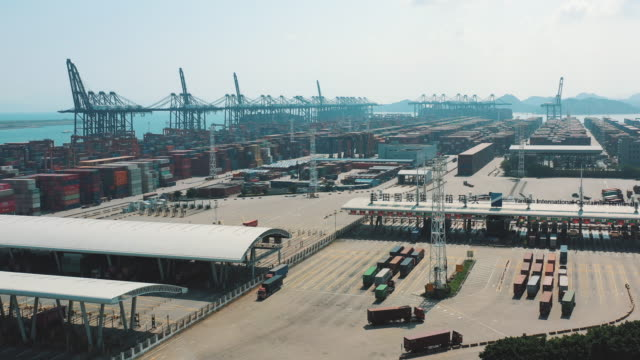 aerial view of container ship terminal in shenzhen, china - trade war stock videos & royalty-free footage