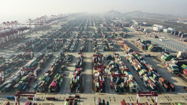 aerial view of container terminal at sunset - global communications video stock e b–roll