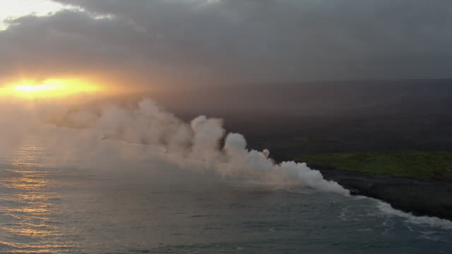 aerial view of cooling lava flow at hawaii volcanoes national park during sunset. - big island hawaii islands stock videos & royalty-free footage