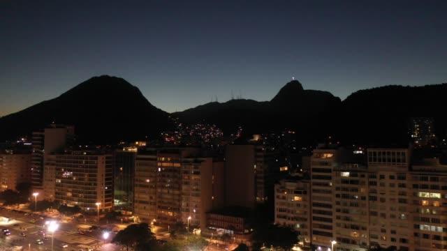aerial view of copacabana beach at night, rio de janeiro - copacabana beach stock videos & royalty-free footage