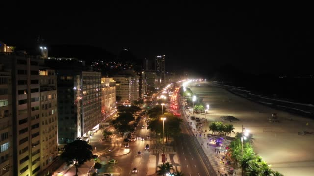 aerial view of copacabana beach at night, rio de janeiro - avenue stock videos & royalty-free footage