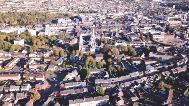 aerial view of cork, ireland on a sunny afternoon. - アイルランド共和国点の映像素材/bロール
