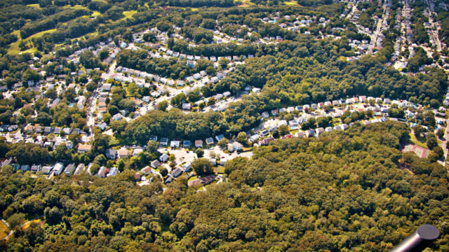 aerial view of country. tree area. forest. house. small city. - massachusetts stock videos & royalty-free footage
