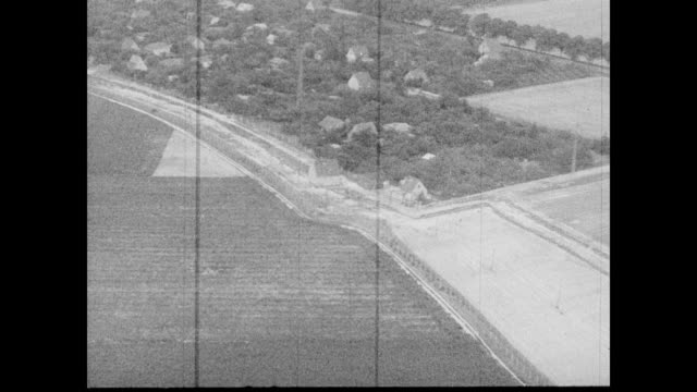 / aerial view of countryside / aerial of possible berlin wall construction / aerial of rhine river cutting through the city streets. aerial view of... - 1962 stock videos & royalty-free footage