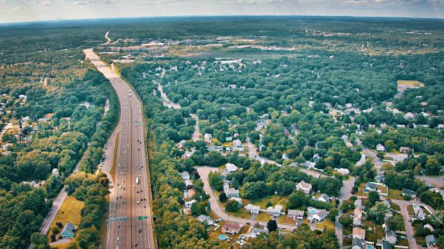 stockvideo's en b-roll-footage met luchtfoto van het platteland. hiway. weg. huis. boom. forest. - massachusetts