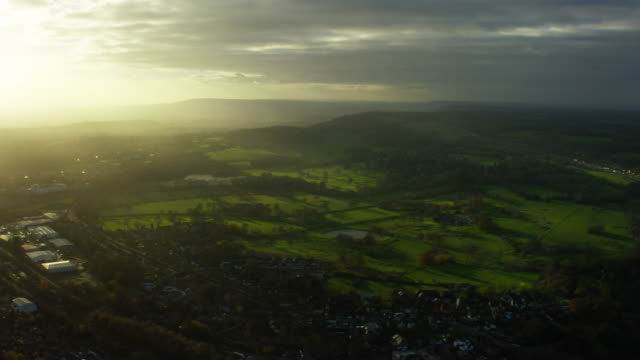 aerial view of countryside outside city of london - m25 video stock e b–roll