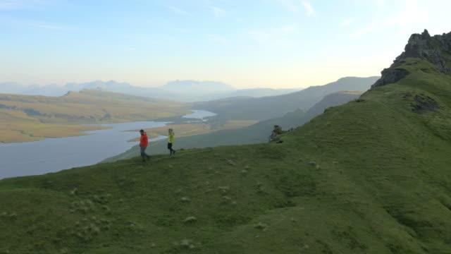 Aerial view of couple hill walking Trotternish Ridge