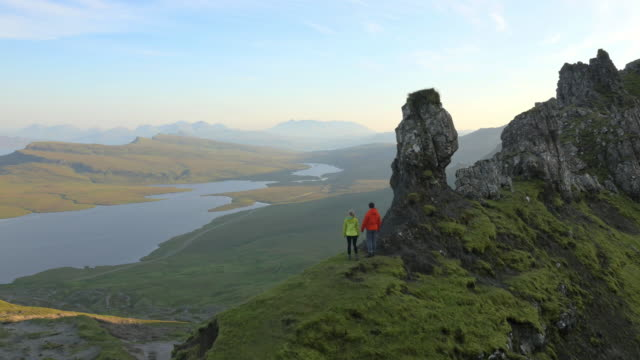 aerial view of couple hill walking trotternish ridge - scotland stock videos & royalty-free footage