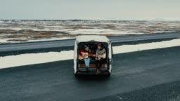 Aerial view of couple in camper van in Iceland