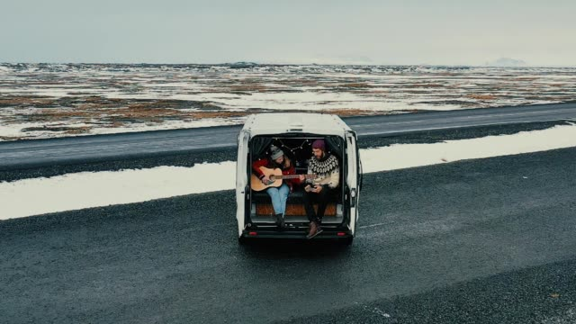 aerial view of couple in camper van in iceland - camper van stock videos & royalty-free footage