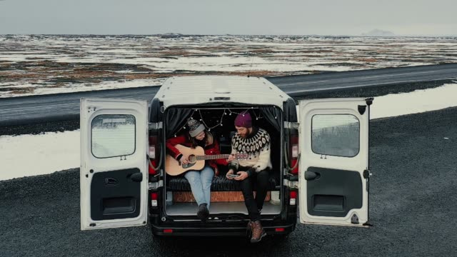 aerial view of couple in camper van in iceland - van stock videos & royalty-free footage