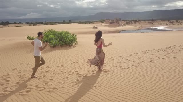 aerial view of couple running in the sand dunes of jalapão, tocantins - tocantins stock videos and b-roll footage