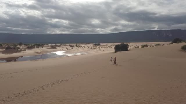 aerial view of couple walking in the sand dunes of jalapão, tocantins - jalapao state park stock videos and b-roll footage