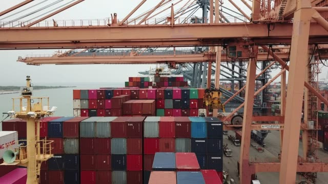 aerial view of cranes unloading cargo ship - cargo container stock videos & royalty-free footage