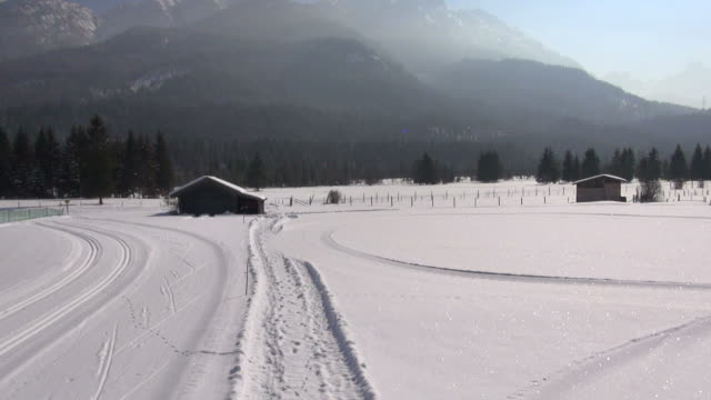 ws aerial view of cross country ski tracks in winter landscape in the karwendel mountains - karwendel mountains stock videos and b-roll footage