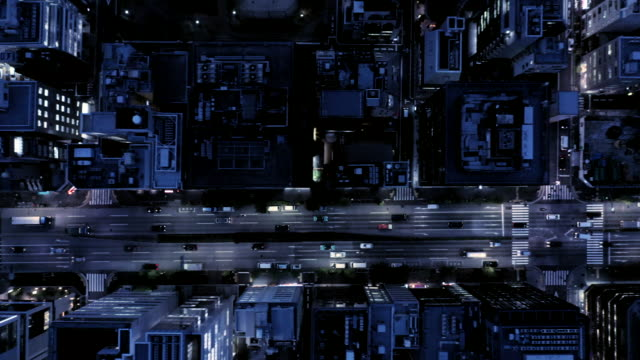 aerial view of crossroad at night - commercial land vehicle stock videos & royalty-free footage
