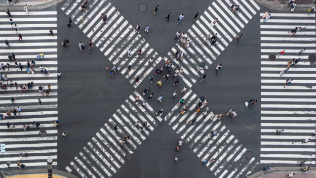 aerial view of crowd people  pedestrians and cars crossing intersection road in ginza, tokyo, japan - zoom out stock videos & royalty-free footage