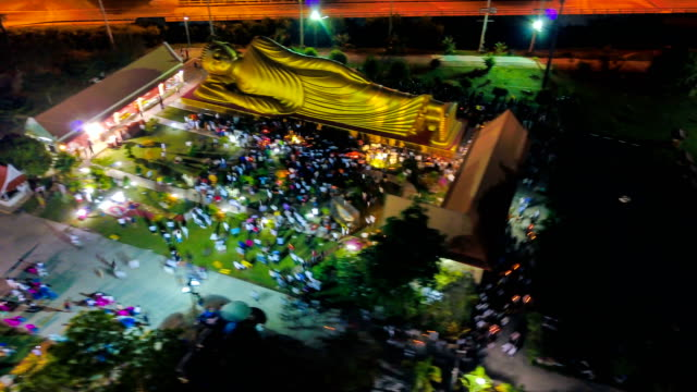 Aerial view of Crowd walking with Candle Light on Magha Puja Day in Songkhla Thailand