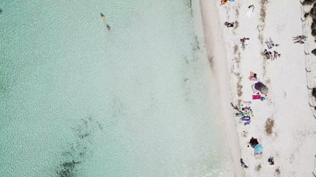 aerial view of crowded beach in summer, menorca, spain - minorca stock videos & royalty-free footage