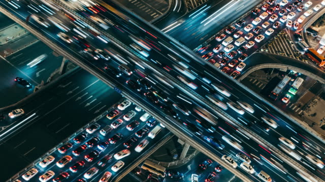 t/l ms ha zo aerial view of crowded road intersection at rush hour, night - motorway stock videos & royalty-free footage