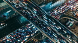 T/L MS HA Aerial View of Crowded Road Intersection at rush hour, Night