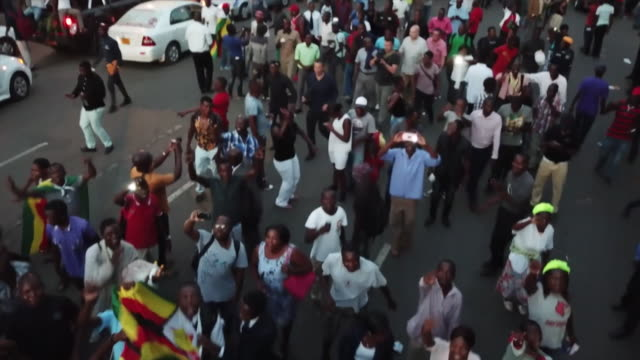 aerial view of crowds celebrating robert mugabe's resignation in harare - coup d'état stock videos & royalty-free footage