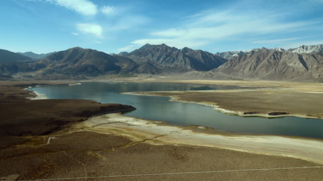 aerial view of crowley lake and the sherwin mountain range. - basin and range province stock videos and b-roll footage