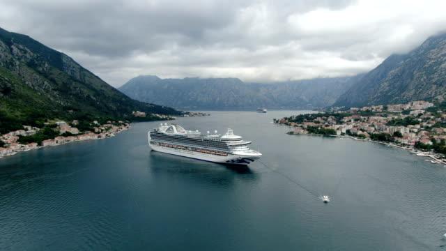 vídeos de stock e filmes b-roll de aerial view of cruise ship, bay of kotor/  adriatic coast , montenegro - cruzeiro