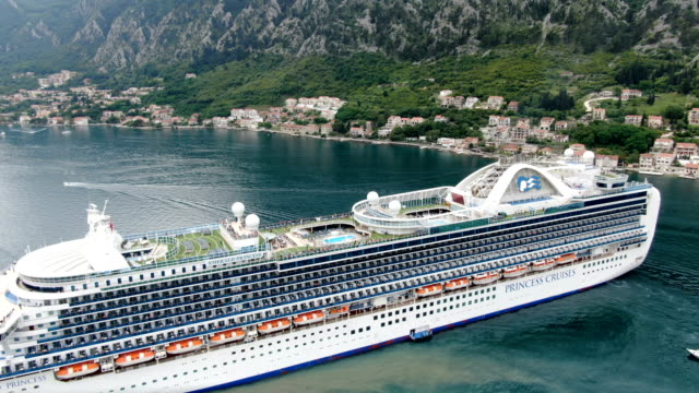vídeos de stock e filmes b-roll de aerial view of cruise ship, bay of kotor/  adriatic coast , montenegro - embarcação comercial