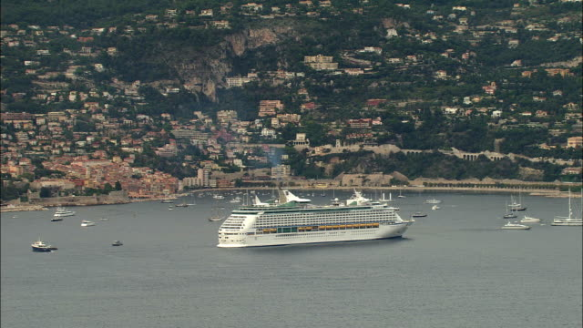 ws aerial view of cruise ship in villefranche harbor, nice, provence, france - kreuzfahrtschiff stock-videos und b-roll-filmmaterial