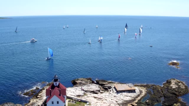 aerial view of cuckol's lighthouse and sailboat rac in boothbay harbor maine - maine stock videos & royalty-free footage