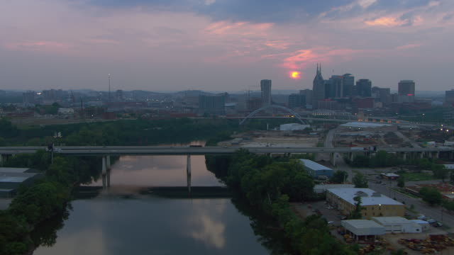 aerial view of cumberland river with downtown nashville during sunset, tennessee, united states of america. - 1 minute or greater stock videos & royalty-free footage