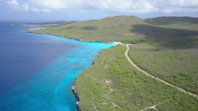 aerial view of curacao coastline and road - coastal feature stock videos & royalty-free footage