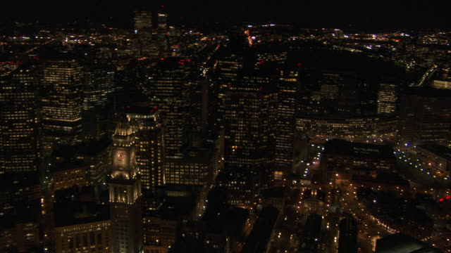 aerial view of custom house tower with modern skyscrapers at night in downtown boston, massachusetts, united states of america - custom house tower stock videos & royalty-free footage