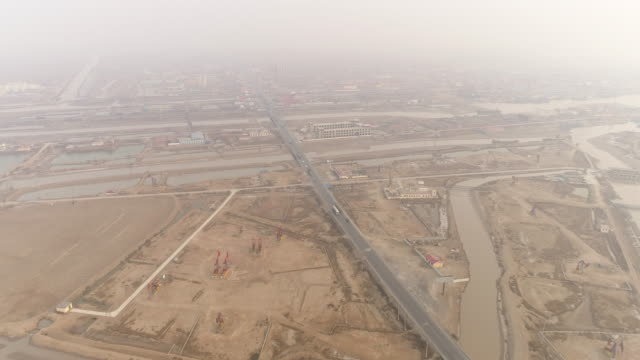 Aerial view of Dagang oil field oil tank truck and smog on March 17 2017 in Huanghua China