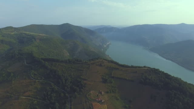 aerial view of danube river bend in serbia stock video. iron gate gorge at djerdap national part in serbia. - river bend land feature stock videos & royalty-free footage
