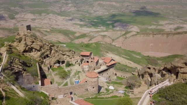 aerial view of david gareja monastery complex / davit, gareja, kakheti - azerbaigian video stock e b–roll
