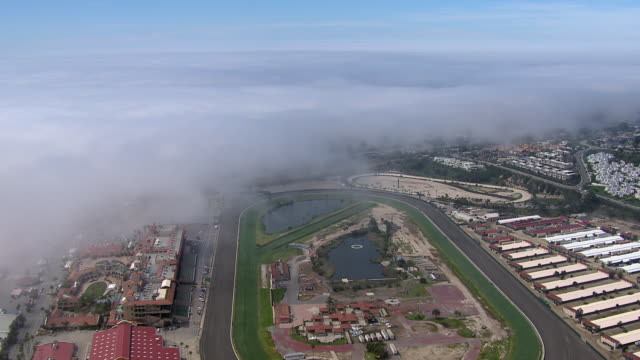 aerial view of del mar racetrack in california with low clouds. - pferderennbahn stock-videos und b-roll-filmmaterial