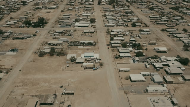 aerial view of desert ghost town - area selvatica video stock e b–roll