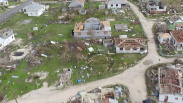vidéos et rushes de aerial view of destruction caused by hurricane irma on the island of barbuda - destruction